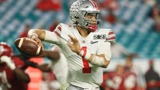 Justin Fields attempts a pass with Ohio State during the 2020 season.